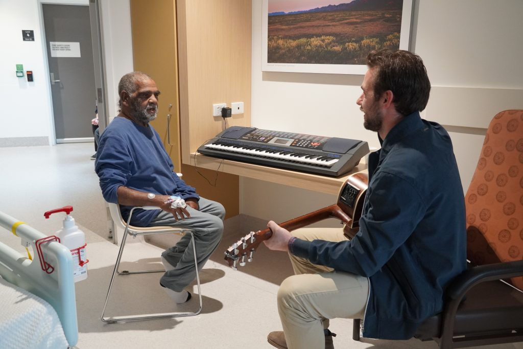 Brian and Jake jamming in Brian's hospital room